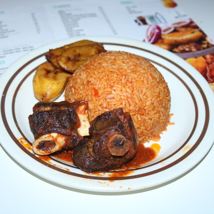 Jollof Rice , Fried Plantain & Goat Meat